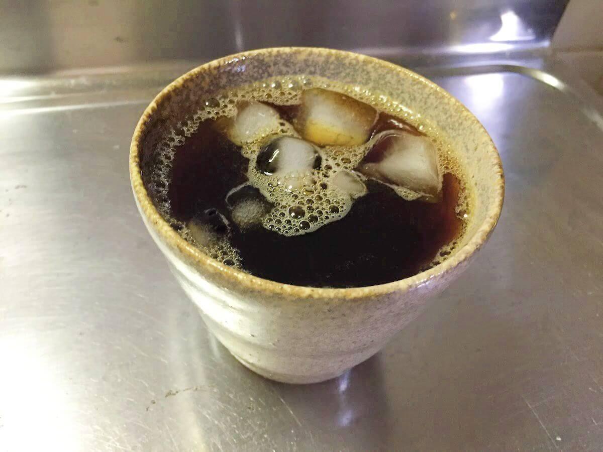 氷が溶けたアイスコーヒー